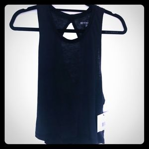 Beyond Yoga Tops - Beyond Yoga NWT black cross back tee size M